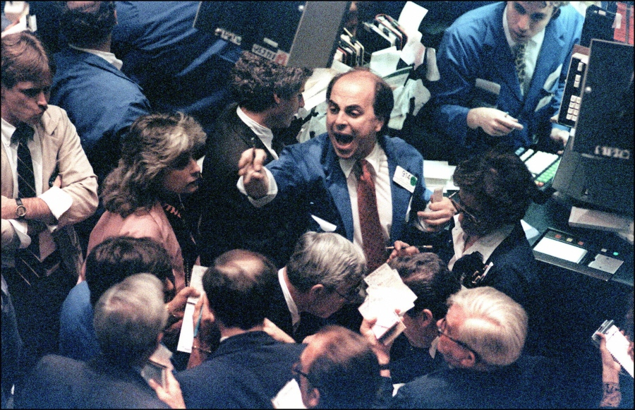 A trader (c) on the New York Stock Exchange shouts
