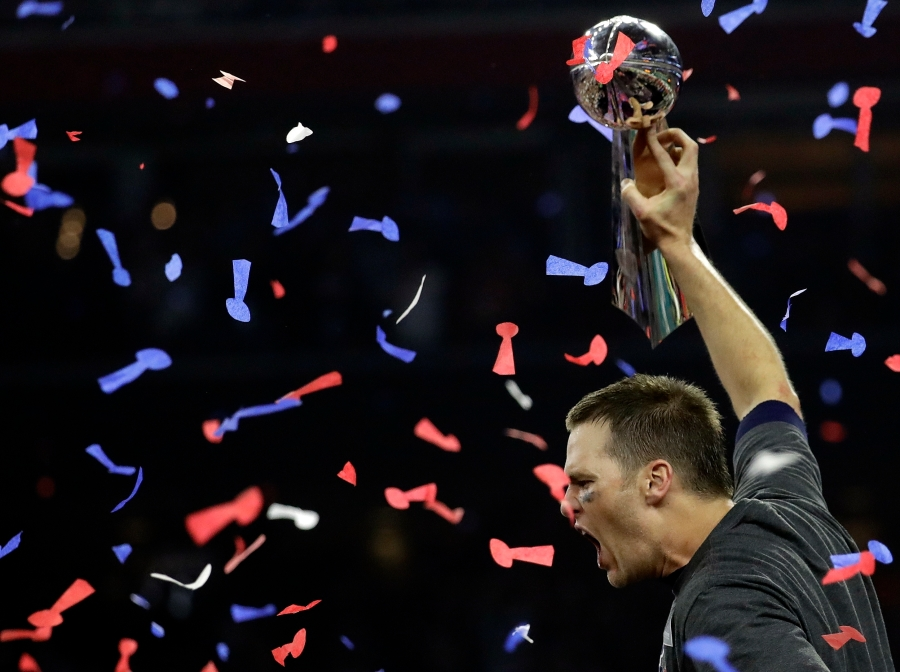 New England Patriots' Tom Brady hoists the Vince Lombardi Trophy after the NFL Super Bowl 51 football game against the Atlanta Falcons Sunday, Feb. 5, 2017, in Houston. The New England Patriots won 34-28 in overtime. (AP Photo/Eric Gay)